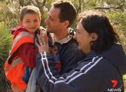 Simon Kruger is surrounded by his elated parents on Sunday, moments after a helicopter rescued him from the outback.