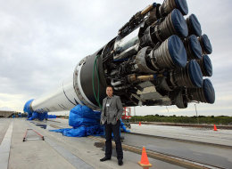 Elon Musk, founder of Sapcex and Tesla, stands in front of a Spacex rocket. Elon Musk is promising to reveal design plans for his Hyperloop technology on Monday. (Spacex)