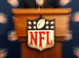 FILE - In this file photo taken Dec. 14, 2011, the NFL logo is seen as NFL Commissioner Roger Goodell speaks during a new conference after the NFL owners meeting in Irving, Texas. NFL owners will meet in Atlanta on Tuesday, May 22, 2012. (AP Photo/LM Otero, file)