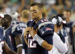 Quarterback Tom Brady #12 of the New England Patriots stands on the sideline during a preseason game against the Philadelphia Eagles on August 9, 2013 at Lincoln Financial Field in Philadelphia, Pennsylvania. The Patriots won 31-22. (Photo by Hunter Martin/Philadelphia Eagles/Getty Images)