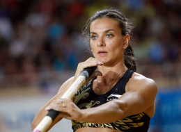 Russia's Yelena Isinbayeva competes in the women's pole vault at the Herculis international athletics meeting, at the Louis II Stadium in Monaco, Friday, July 20, 2012.