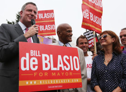 Democratic candidate for mayor and Public Advocate Bill de Blasio (L) speaks as actor, singer and supporter Harry Belafonte (C) and actress Susan Sarandon (R) look on on Aug. 19, 2013 in New York City.  (Mario Tama/Getty Images)