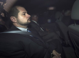 City of Toronto Police Constable James Forcillo is pictured through an unmarked police van as he arrives at the Old City Hall courthouse facing second degree murder charges from the shooting of Sammy Yatim in Toronto, on Tuesday, August 20, 2013. THE CANADIAN PRESS/Nathan Denette