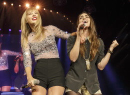 Taylor Swift performs with Sara Bareilles on Monday night in Los Angeles.