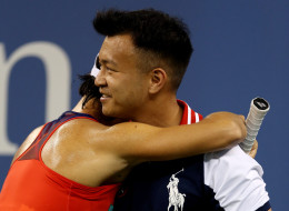Francesca Schiavone hugs a ball boy during her match against Serena Williams at the 2013 US Open.