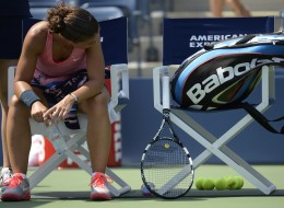 Sara Errani of Italy sits on the sideline during her match against Flavia Pennetta of Italy during the 2013 US Open singles at the USTA Billie Jean King National Tennis Center in New York on August 29, 2013. (Photo credit should read TIMOTHY CLARY/AFP/Getty Images)