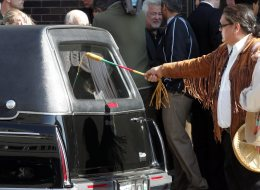 A drummer pays homage to Brian Sinclair whose body was placed in a hearse after funeral service in this Sept 26, 2008 photo, in Winnipeg. Winnipeg police say they will launch a criminal investigation into the death of a homeless man who waited for 34 hours in a hospital's emergency room. THE CANADIAN PRESS/ Winnipeg Free Press - Wayne Glowacki