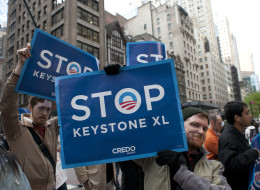 Environmental activists march through midtown protesting the proposed Keystone XL pipeline, May 13, 2013 in New York. TransCanada's Keystone XL pipeline will increase carbon emissions by the equivalent of 51 coal-fired power plants or 37 million new cars on the road, says a new report from a coalition of environmental groups. (DON EMMERT/AFP/Getty Images)