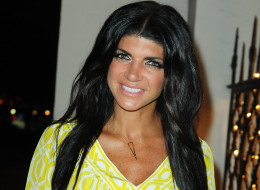 Did Teresa Giudice have something to do with a fundraiser to help ease her legal fees? Here, she signs copies of her book <em>Fabulicious on the Grill</em> on June 20 in Coral Gables, Fla. (Vallery Jean/FilmMagic)