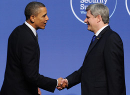 Canadian Prime Minister Stephen Harper shakes hands with U.S. President Barack Obama on April 12, 2010 in Washington, DC.  AFP PHOTO / JEWEL SAMAD