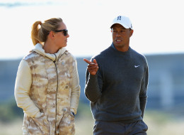 Lindsey Vonn and Tiger Woods walk the course ahead of the 142nd Open Championship at Muirfield on July 15, 2013 in Gullane, Scotland.