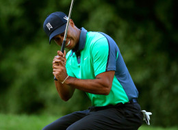 Tiger Woods reacts after missing a putt on the sixth green during the First Round of the BMW Championship at Conway Farms Golf Club on September 12, 2013 in Lake Forest, Illinois.
