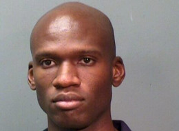 In this handout provided by the Fort Worth Police Department, suspect Aaron Alexis poses for a mug shot after being arrested on September 4, 2010 for discharging a firearm inside city limits, a Class A misdemeanor in Fort Worth, Texas.