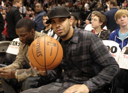 Drake shows his love for the game sitting courtside during the contest featuring the Toronto Raptors and the Cleveland Cavaliers at the Air Canada Centre in Toronto