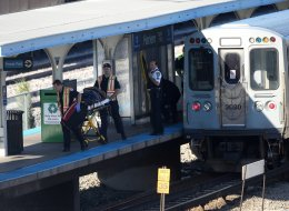 An injured rider is transported as dozens of people were taken to hospitals after a CTA train ran head-on into another train that was stopped at a Blue Line station in Forest Park, Illinois, Monday, September 30, 2013. (Chuck Berman/ Chicago Tribune/MCT via Getty Images)