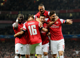 Mesut Oezil (C) of Arsenal celebrates scoring his team's 1st goal with (L-R) Bacary Sagna,  Aaron Ramsey, Kieran Gibbs Mathieu Flamini and Olivier Giroud during the UEFA Champions League Group F match between Arsenal FC and SSC Napoli at Emirates Stadium on October 1, 2013 in London, England.