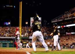 PITTSBURGH, PA - OCTOBER 06: Josh Harrison #5 of the Pittsburgh Pirates celebrates scoring in the eighth inning against the St. Louis Cardinals during Game Three of the National League Division Series at PNC Park on October 6, 2013 in Pittsburgh, Pennsylvania.  (Photo by Jared Wickerham/Getty Images)