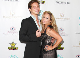 Adrienne Maloof said Jacob Busch didn't have a number on his forehead when she met him. Here, they pose at the Brent Shapiro Foundation's Summer Spectacular on Sept. 7. (Fame Flynet)
