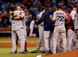 Mike Napoli #12 and Jonny Gomes #5 of the Boston Red Sox celebrate with teammates after defeating the Tampa Bay Rays 3-1 in Game Four of the American League Division Series at Tropicana Field on October 8, 2013 in St Petersburg, Florida.  (Photo by Mike Ehrmann/Getty Images)