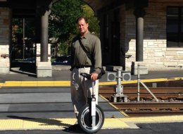 Tim Goebel of Commute Connect poses with an electric unicycle at the Highland Park, Ill. Metra station. Goebel took a spin in the cycle in downtown Chicago this week.