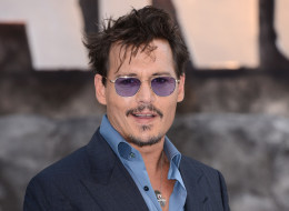 LONDON, ENGLAND - JULY 21:  Johnny Depp attends the UK Premiere of 'The Lone Ranger' at Odeon Leicester Square on July 21, 2013 in London, England.  (Photo by Karwai Tang/WireImage)