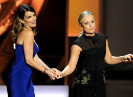 LOS ANGELES, CA - SEPTEMBER 22:  Writer/actresses Tina Fey (L) and Amy Poehler speak onstage during the 65th Annual Primetime Emmy Awards held at Nokia Theatre L.A. Live on September 22, 2013 in Los Angeles, California.  (Photo by Kevin Winter/Getty Images)