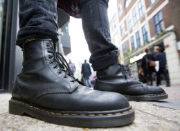 A pedestrian wearing Dr. Martens boots poses for a photograph outside the footwear company's store in Convent Garden in London, U.K. (Simon Dawson/Bloomberg via Getty Images)