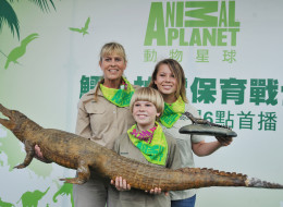 (L to R) Terri Irwin, her son Robert and daughter Bindi pose for photographs during a promotional event for Animal Planet's new series 'Steve Irwin's Wildlife Warriors' at Taipei City Zoo on October 20,2013. The channel will debut a series of eight films 'Steve Irwin's Wildlife Warriors' documenting the day-to-day conservation work and lives of the Irwin family - daughter Bindi, son Robert, and mother Terri. Steve Irwin, aka 'The Crocodile Hunter' and husband of Terri was an Australian wildlife