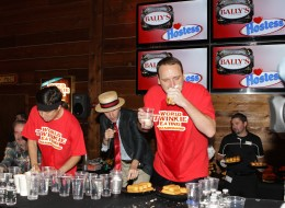 Matt Stonie, left, and Joey Chestnut, right, square off in a rectangular snack cake-eating contest on Saturday.