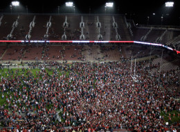 Stanford Cardinal fans storm the field after Stanford beat the Oregon Ducks at Stanford Stadium on November 7, 2013 in Palo Alto, California.  (Photo by Ezra Shaw/Getty Images)