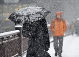 A pedestrian shields himself with an umbrella as he walks down the street on March 5, 2013 in Chicago, Illinois. (Photo by Brian Kersey/Getty Images)