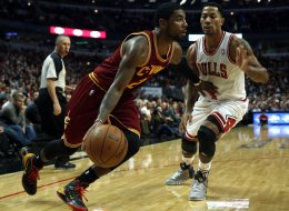 Derrick Rose of the Chicago Bulls guards Kyrie Irving of the Cleveland Cavaliers in the 4th quarter at the United Center in Chicago on Monday, Nov. 11, 2013. The Bulls won, 96-81. (Scott Strazzante/Chicago Tribune/MCT via Getty Images)