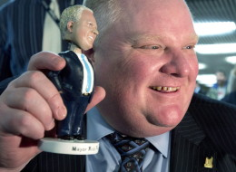 Mayor Rob Ford with a Rob Ford bobblehead. Ford Motor Co. says it won't tolerate Rob Ford supporters making