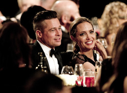 Angelina Jolie did not buy Brad Pitt an island. Here, they attend the 2013 Governors Awards, presented by the American Academy of Motion Picture Arts and Sciences (AMPAS), at the Grand Ballroom of the Hollywood and Highland Center in Hollywood Nov. 16. (ROBYN BECK/AFP/Getty Images)
