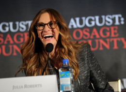 What does actress Julia Roberts think of Jennifer Lawrence? Here, she speaks at the AUGUST: OSAGE COUNTY press conference on November 25, 2013 in New York City.  (Photo by Bryan Bedder/Getty Images for The Weinstein Company)