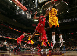 Andrew Bynum #21 of the Cleveland Cavaliers goes up for the shot against Joakim Noah #13 of the Chicago Bulls at The Quicken Loans Arena on November 30, 2013 in Cleveland, Ohio. (Photo by David Liam Kyle/NBAE via Getty Images)