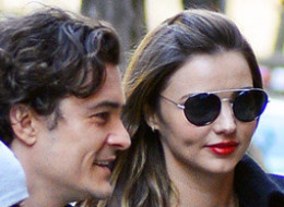 Orlando Bloom and Miranda Kerr reunite with son Flynn out on the Upper East Side in New York City on Nov. 30.