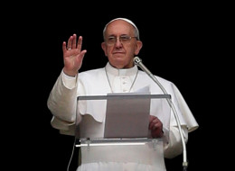 Pope Francis, pictured in prayer last March at the Vatican, told church goers he once manned the door at a nightclub.
