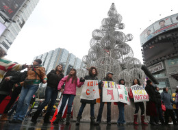 After taking over the intersection of Yonge and Dundas, Idle No More protesters moved over to the Square to continue their protest. on December 21, 2012. STEVE RUSSELL/TORONTO STAR