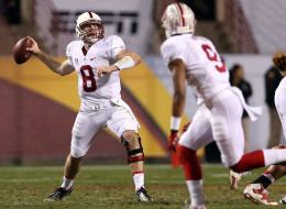 Quarterback Kevin Hogan #8 of the Stanford Cardinal drops back to pass during the Pac 12 Championship game against the Arizona State Sun Devils at Sun Devil Stadium on December 7, 2013 in Tempe, Arizona.