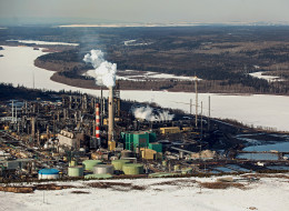The Suncor Energy Inc. base plant is seen in this aerial photograph of the Athabasca Oil Sands near Fort McMurray, Alberta, Canada, on Tuesday, March 26, 2013. Photographer: Brett Gundlock/Bloomberg via Getty Images