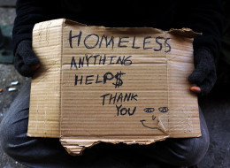 NEW YORK, NY - DECEMBER 04:  A person in economic difficulty holds a homemade sign asking for money along a Manhattan street on December 4, 2013 in New York City.  According to a recent study by the by the United States Department of Housing and Urban Development, New York City's homeless population increased by 13 percent at the beginning of this year. Despite an improving local economy, as of last January an estimated 64,060 homeless people were in shelters and on the street in New York. Only