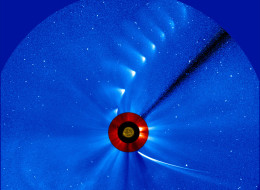 Comet ISON comes in from the bottom right and moves out toward the upper right, getting fainter and fainter, in this time-lapse image from the ESA/NASA Solar and Heliospheric Observatory. The image of the sun at the center is from NASA's Solar Dynamics Observatory.