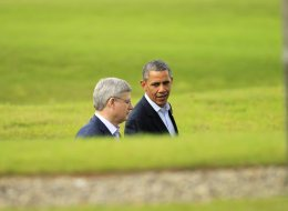U.S. President Barack Obama and Canadian Prime Minister Stephen Harper at the G-8 summit in Enniskillen, Northern Ireland, on Tuesday, June 18, 2013. The federal government is staying quiet on reports it has caved to U.S. demands on intellectual property and drug costs in a new Pacific trade deal currently under negotiation. (AP Photo/Matt Dunham)