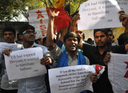 Members of The All India Students Federation (AISF) shout slogans and wave placards during a protest in front of the US consulate in Hyderabad on December 19, 2013, following the arrest of New York-based Indian diplomat Devyani Khobragade. (STRDEL/AFP/Getty I