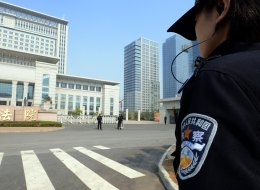 Chinese police guard the Shandong high court building in Jinan, east China Shandong province on October 25, 2013. (GOH CHAI HIN/AFP/Getty Images)