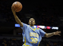 Southern University's Tre Lynch shoots past Marquette's Juan Anderson (10) and Derrick Wilson (12) during the second half of an NCAA college basketball game Friday, Nov. 8, 2013, in Milwaukee. (AP Photo/Morry Gash)