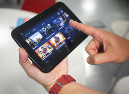 An employee views movie titles on the blinkbox website as he demonstrates Tesco Plc's new Hudl tablet handheld device during its launch in London, United Kingdom, on Monday, Sept. 23, 2013. Tesco, the U.K.'s biggest retailer, today launched it's own tablet handheld device which will run Google Inc.'s Android operating system. Photographer: Simon Dawson/Bloomberg via Getty Images