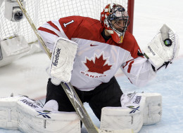 Canada's goalie Roberto Luongo (1) makes a save in the third period of a men's gold medal ice hockey game against USA at the Vancouver 2010 Olympics in Vancouver, British Columbia, Sunday, Feb. 28, 2010.
