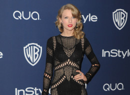Singer Taylor Swift arrives at the 2014 InStyle And Warner Bros. 71st Annual Golden Globe Awards Post-Party on January 12, 2014 in Beverly Hills, California.  (Photo by Jon Kopaloff/FilmMagic)